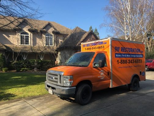 911 Restoration mold removal truck in front of home